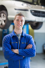 Confident  male mechanic smiling