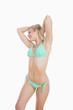 Sensuous young woman in green bikini
