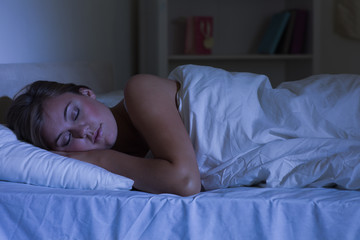 Cute woman sleeping at night