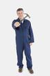 Portrait of technician holding hammer