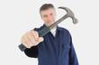 Technician holding hammer