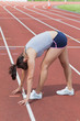 Woman stretching on the track