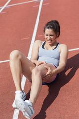 Runner suffering from leg cramp