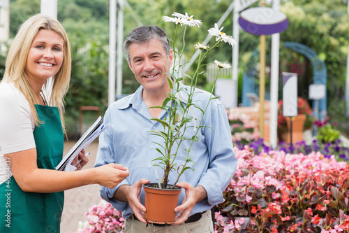 Gardener giving advice to customer