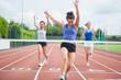 Athlete celebrates race win at finish line