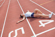 Woman taking break on track field
