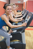 Four women on exercise bikes