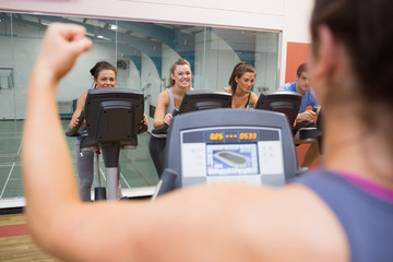 Happy people in spinning class