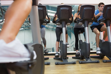 People taking a spinning class