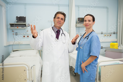 Happy doctor and nurse