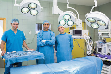 Several Surgeons surrounding an operation table