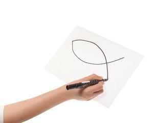 Hand girl drawing a Christian fish symbol