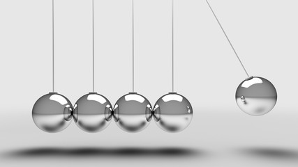 Balancing balls newtons cradle over light grey background