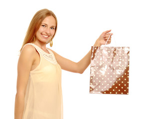 A portrait of a young woman with a shopping bag