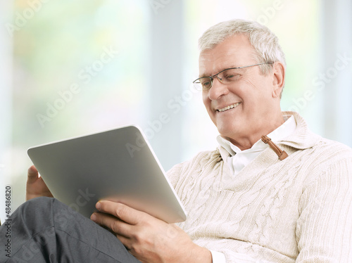 Senior Businessman Working At Home