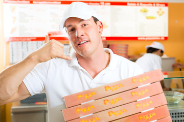 Delivery service - man holding pizza boxes