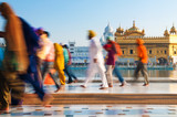 Group of Sikh pilgrims walking by the Golden Temple