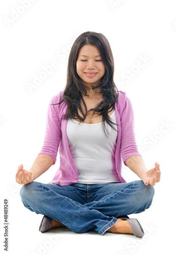 Asian Chinese woman yoga lotus pose