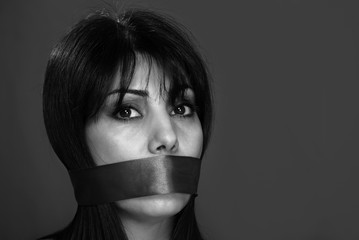 Gagged woman not allowed to speak, monochrome