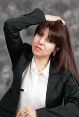 Stress of job loss, woman holding head