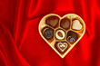 chocolate pralines in golden heart shape gift box