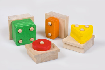 Colorful wooden baby blocks in various shapes