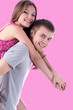beautiful smiling couple on pink background