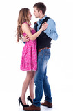 Fototapety young couple dancing over white background