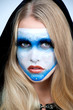 Beautiful young woman in carnival mask , face-art