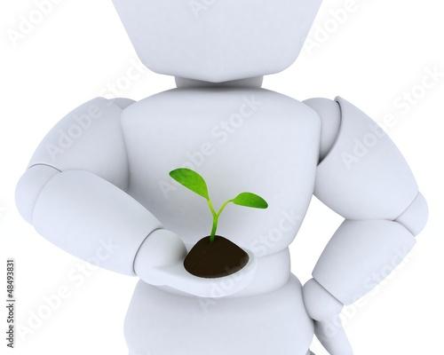 man nurturing a  seedling plant