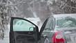 Senior man sitting in vehicle in winter