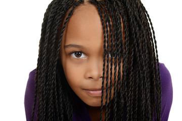 young black child with braids over face