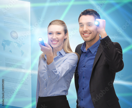 man and woman with flashlights