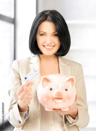 lovely woman with piggy bank and money