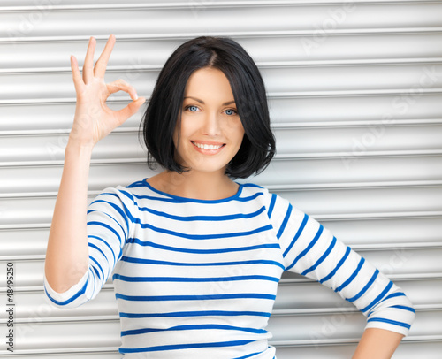happy teenage girl showing ok sign