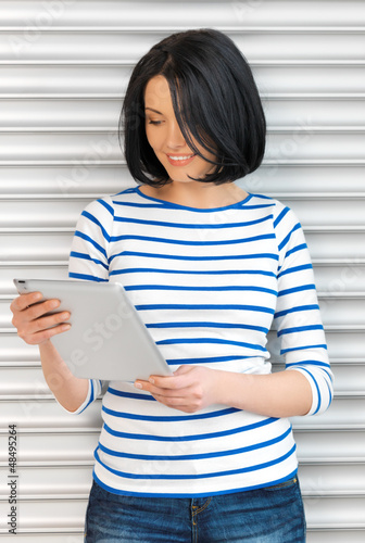 happy teenage girl with tablet pc computer