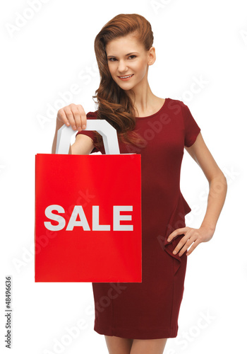 teenage girl in red dress with sale sign