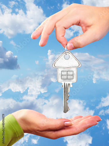 Hand with a home key.