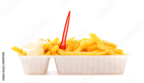 Portion of fries with mayonnaise and plastic fork