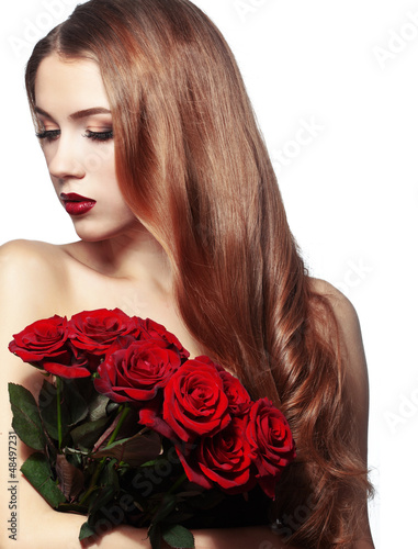 Beautiful girl holding bunch of roses