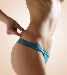 body of beautiful woman measuring fat