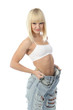 Portrait of athletic blonde girl in lingerie and high torn jeans