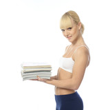 Athletic girl doing fitness exercises with a stack of magazines