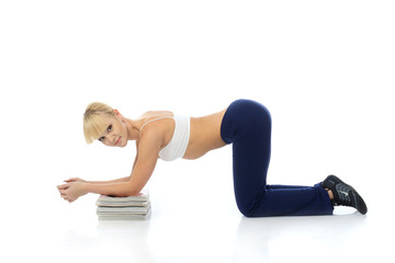 Athletic girl doing exercises