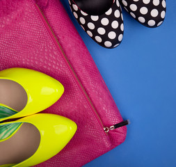 Colorful high heels and sneakskin print bag