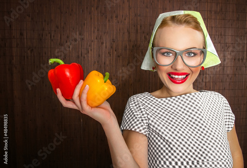 Funny woman cook holading sweet pepper, close up