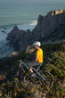 Mountain biker enjoying ocean view
