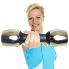 Atletic woman has fun to exercise with free weights