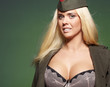 Sexual young blonde in military clothing