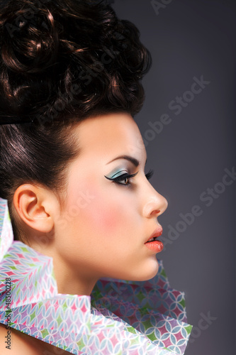 Renaissance. Woman with Frill - Bright Hairstyle and Make Up